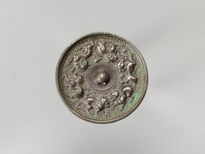 Lot 529 - A CIRCULAR BRONZE MIRROR WITH ANIMALS