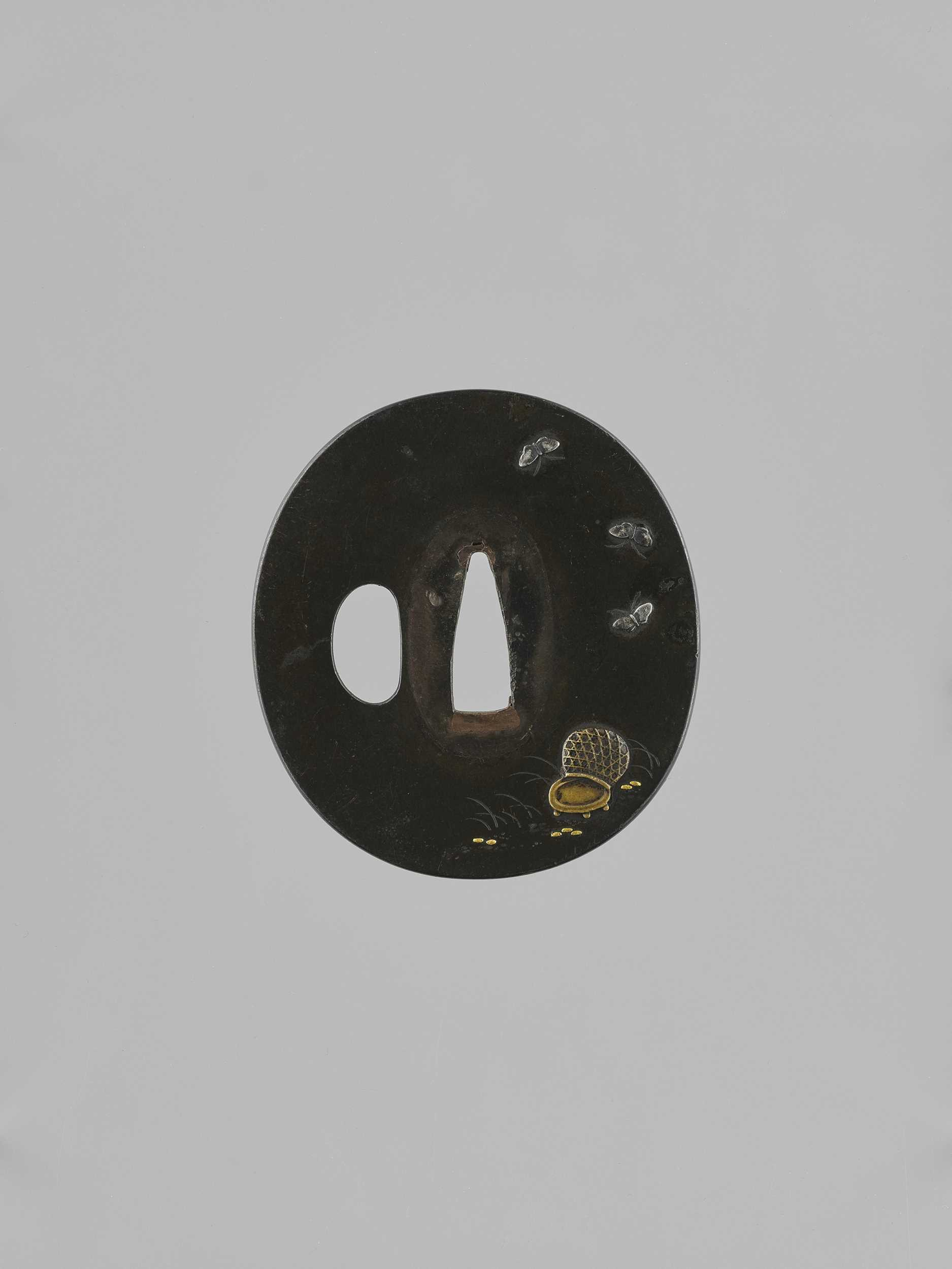 Lot 36 - A SHIBUICHI TSUBA WITH BUTTERFLIES AND BASKET