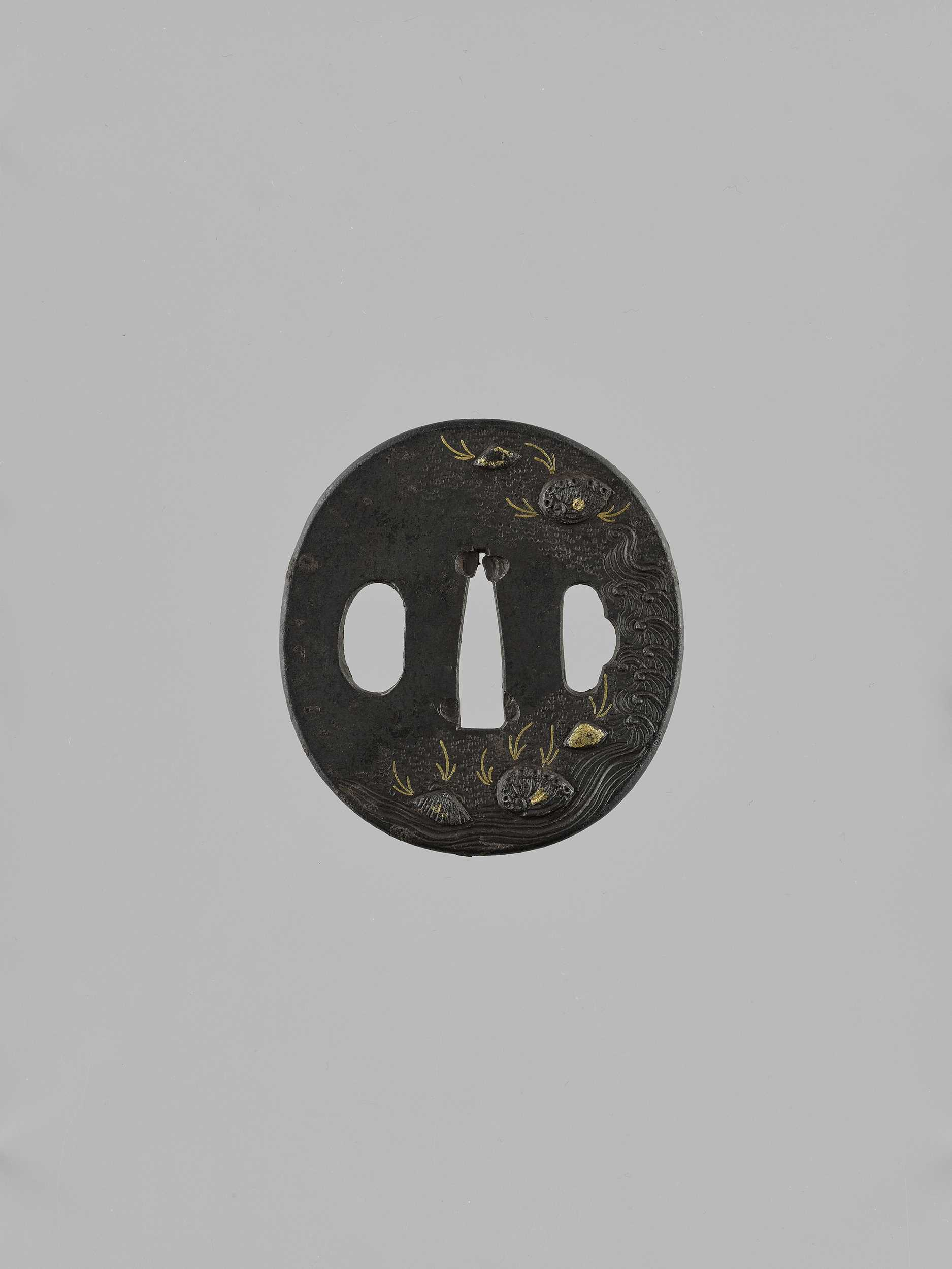 Lot 34 - AN IRON TSUBA WITH SEASHELLS