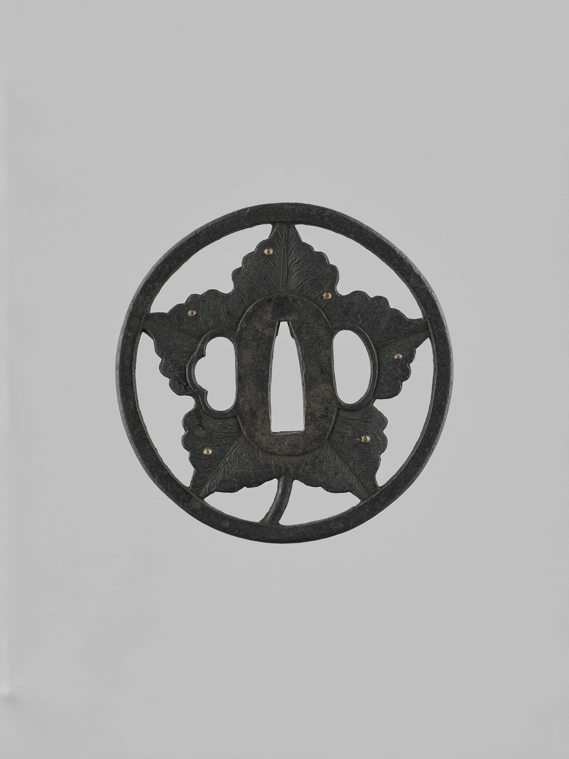 Lot 47 - AN IRON SUKASHI TSUBA