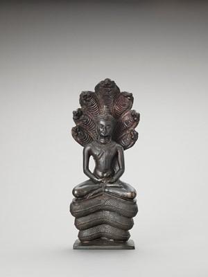A KHMER STYLE BRONZE OF BUDDHA MUCHALINDA