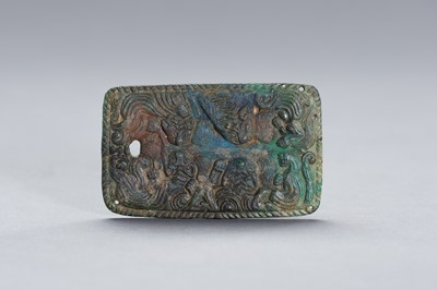 Lot 33 - AN ORDOS STYLE 'TIGER' BRONZE PLAQUE