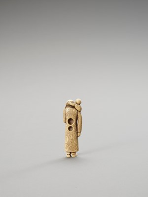 A BONE NETSUKE OF A FOREIGNER WITH CHILD