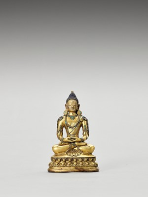 Lot 557 - A SINO-TIBETAN GILT BRONZE FIGURE OF BUDDHA, QING