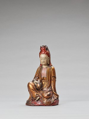Lot 596 - A POLYCHROME AND GILT-LACQUERED WOOD FIGURE OF GUANYIN, QING