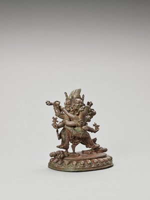 Lot 552 - A HEAVY SINO-TIBETAN BRONZE FIGURE OF MAHAKALA AND CONSORT, QING