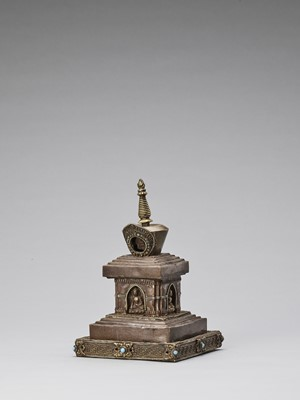 Lot 537 - A TIBETAN COPPER REPOUSSÉ STUPA WITH TURQUOISES, 19TH CENTURY