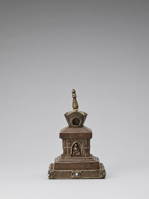 Lot 537 - A TIBETAN COPPER REPOUSSÉ STUPA WITH TURQUOISES, 19TH CENTURY