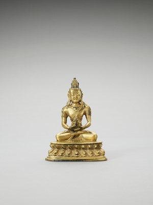 Lot 559 - A FINE SINO-TIBETAN FIRE GILT BRONZE OF AMITAYUS