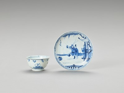 Lot 627 - A BLUE AND WHITE PORCELAIN CUP AND SAUCER, MING