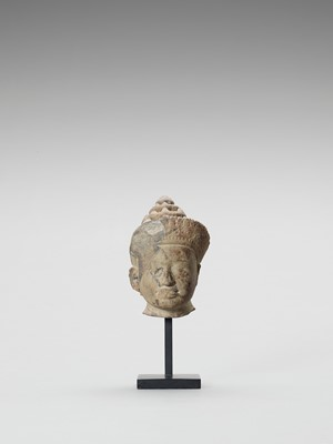 A KHMER SANDSTONE HEAD OF VISHNU, PRE RUP STYLE, LATER 10TH CENTURY