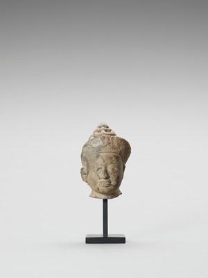 Lot 481 - A KHMER SANDSTONE HEAD OF VISHNU, PRE RUP STYLE, LATER 10TH CENTURY