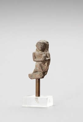 AN INDIAN RED SANDSTONE FRAGMENT DEPICTING A FEMALE WORSHIPPER
