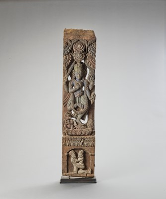 Lot 570 - A LARGE NEPALESE WOOD PILLAR WITH VISHNU, 17th -18TH CENTURY