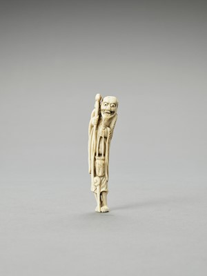 A BONE NETSUKE OF A SENNIN