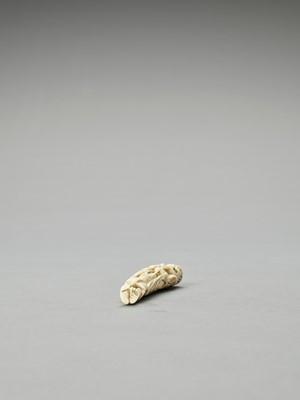 A BONE NETSUKE OF A SENNIN