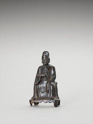 Lot 580 - A BRONZE FIGURE OF A DAOIST SCHOLAR-OFFICIAL, MING