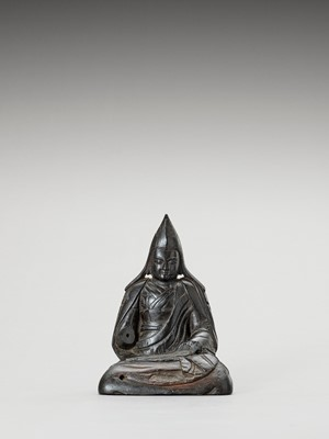 Lot 553 - A TIBETAN HARDWOOD FIGURE OF TSONGKHAPA