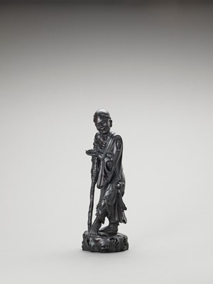 Lot 594 - A ZITAN FIGURE OF A HERMIT, LATE QING TO REPUBLIC