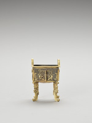Lot 522 - A GILT BRONZE FANGDING CENSER, QING