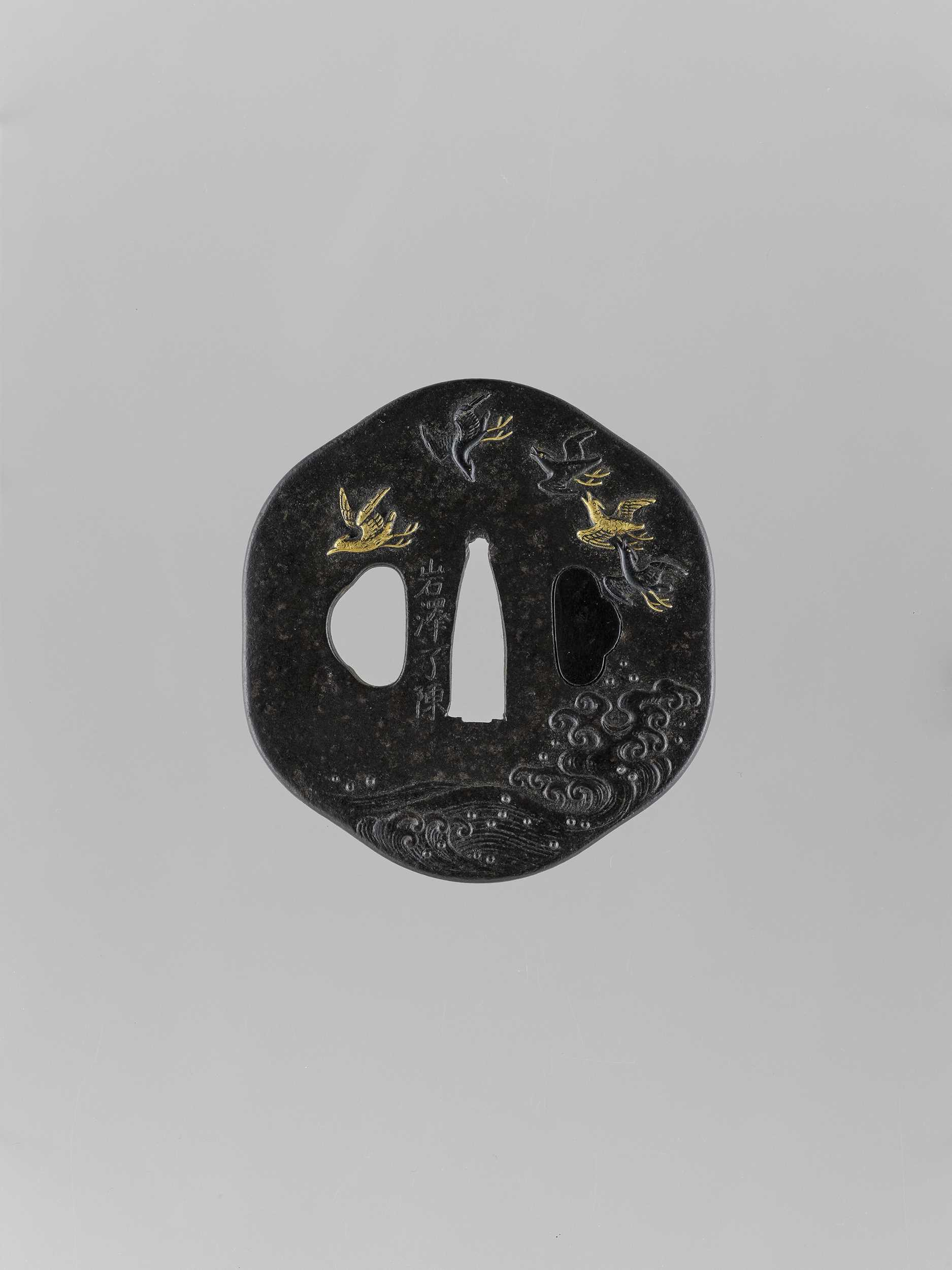 Lot 41 - AN INLAID IRON TSUBA WITH FLYING GEESE