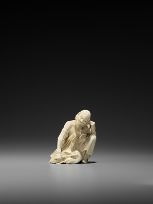 Lot 164 - AN IVORY OKIMONO OF A RAKAN CLEANING HIS EAR