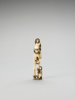 Lot 128 - AN IVORY OKIMONO OF A SKELETON WITH TWO MONKEYS AND SNAKE