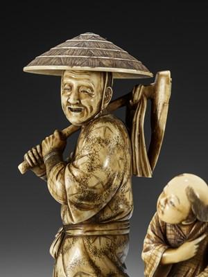 SHODAI: AN IVORY OKIMONO OF A FARMER WITH CHLD