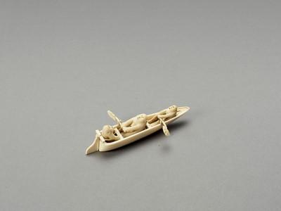 Lot 127 - AN AMUSING IVORY OKIMONO OF MONKEYS IN A BOAT