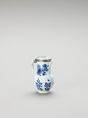 Lot 1106 - A SILVER-MOUNTED BLUE AND WHITE PORCELAIN JUG