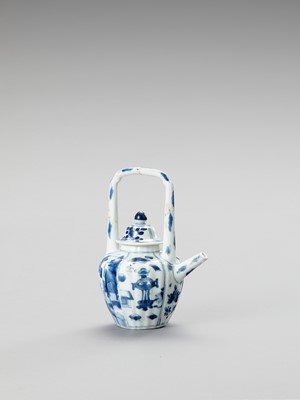 Lot 1104 - A BLUE AND WHITE PORCELAIN TEAPOT