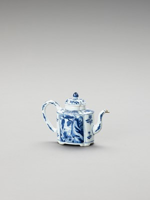 Lot 1101 - A LOBED BLUE AND WHITE PORCELAIN TEAPOT