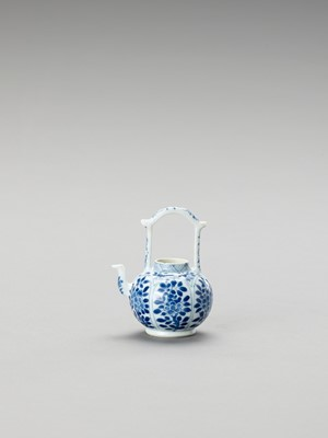 Lot 1102 - A MINIATURE BLUE AND WHITE PORCELAIN TEAPOT