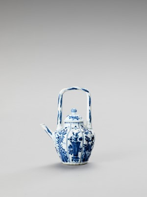 Lot 1103 - A BLUE AND WHITE PORCELAIN TEAPOT