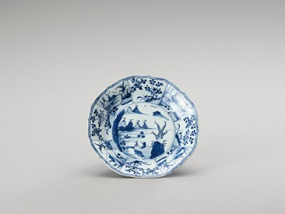 Lot 1113 - A LOBED AND DEEP BLUE AND WHITE PORCELAIN PLATE