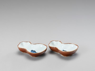 Lot 1120 - A PAIR OF GOURD-SHAPED PORCELAIN SAUCERS