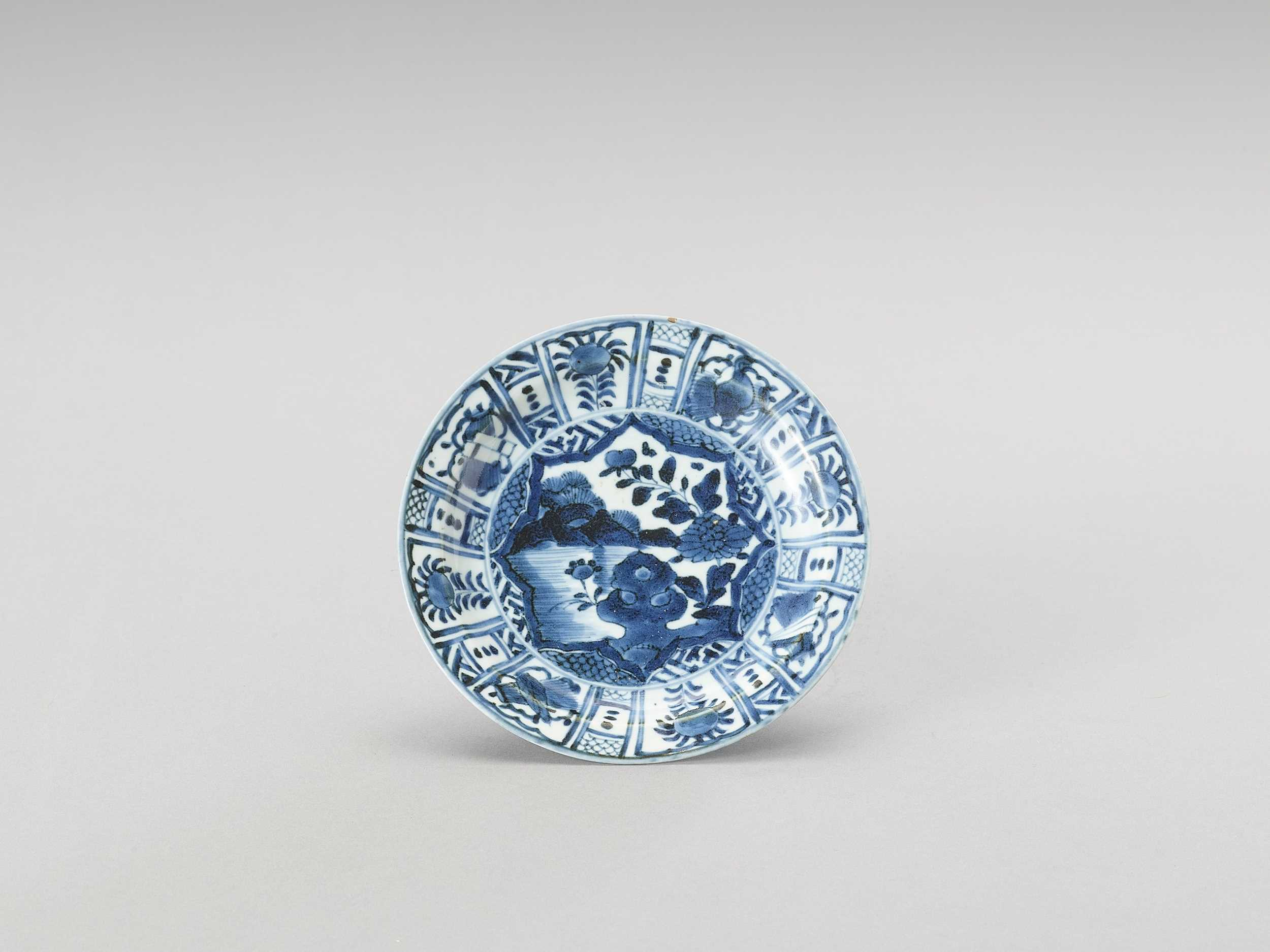 Lot 1023 - A BLUE AND WHITE ARITA PORCELAIN 'FLORAL' DISH
