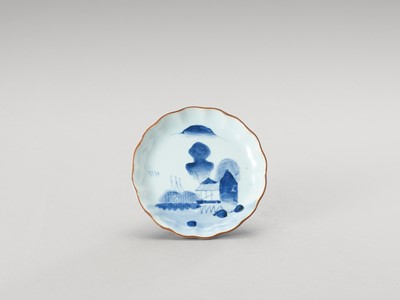 Lot 169 - A SMALL BLUE AND WHITE LOBED PORCELAIN DISH