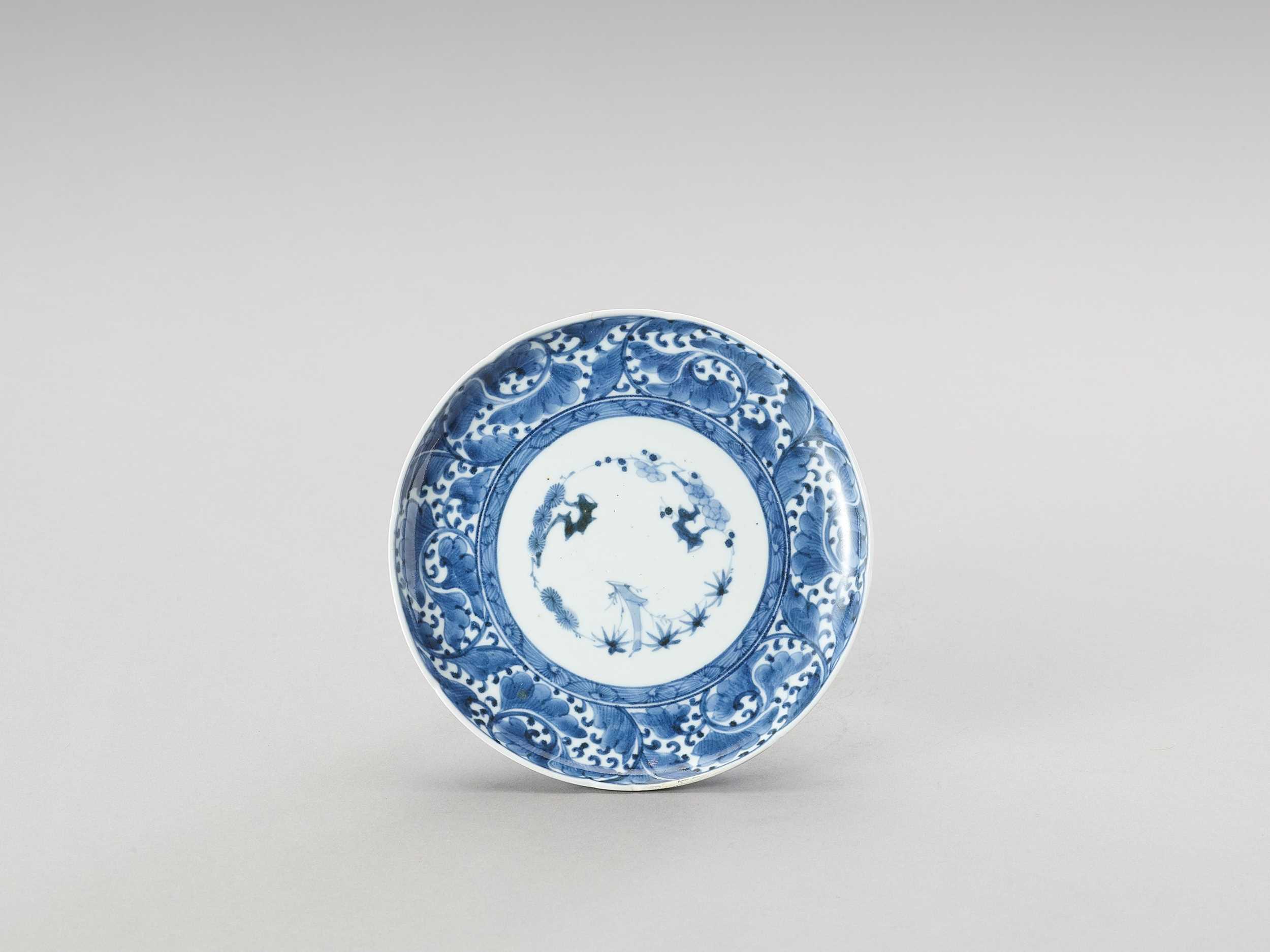 Lot 1028 - A BLUE AND WHITE ARITA PORCELAIN 'FLORAL' DISH