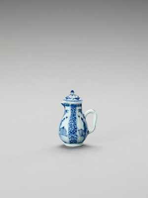 Lot 1033 - A SMALL BLUE AND WHITE PORCELAIN JUG AND COVER