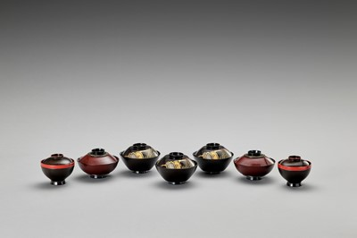 Lot 67 - A SET OF SEVEN LACQUERED BOWLS WITH COVERS