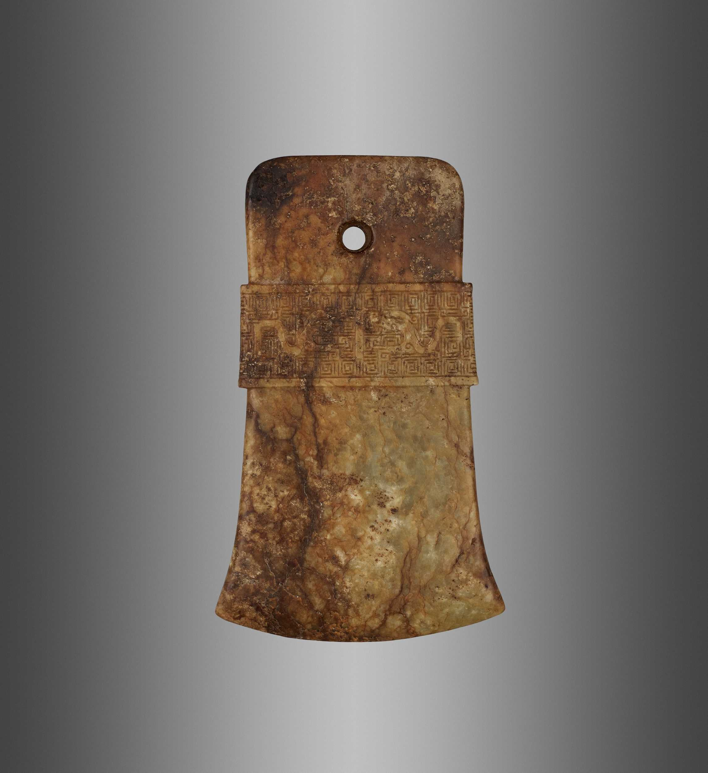 Lot 56 - AN ARCHAISTIC RUSSET AND CELADON JADE AXE, QI, MING DYNASTY