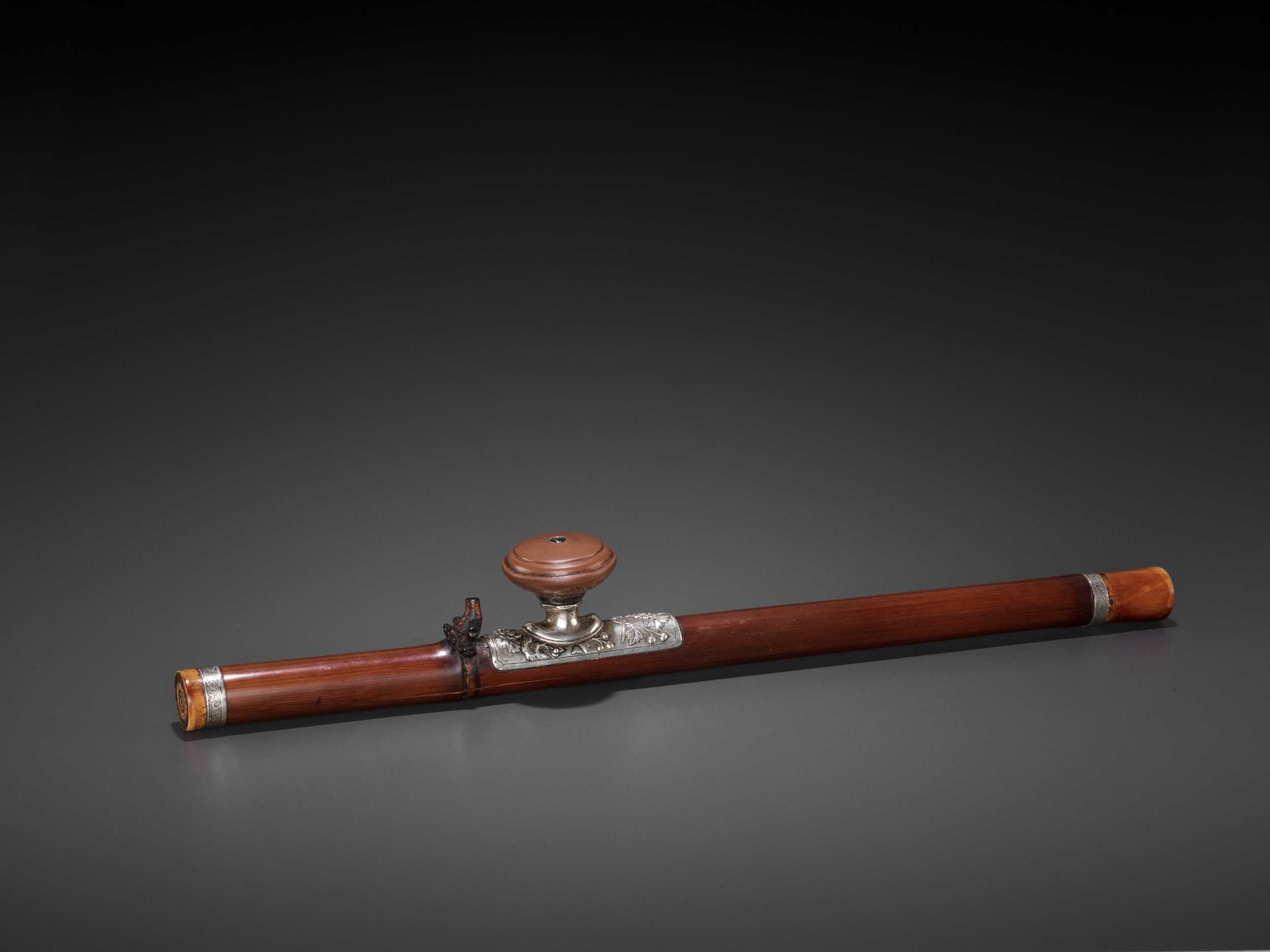 Lot 20 - A BAMBOO OPIUM PIPE WITH IVORY, SILVER AND YIXING CERAMIC FITTINGS, LATE QING TO REPUBLIC