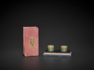 Lot 105 - A PAIR OF CELADON JADE ARCHER'S RINGS, QING DYNASTY