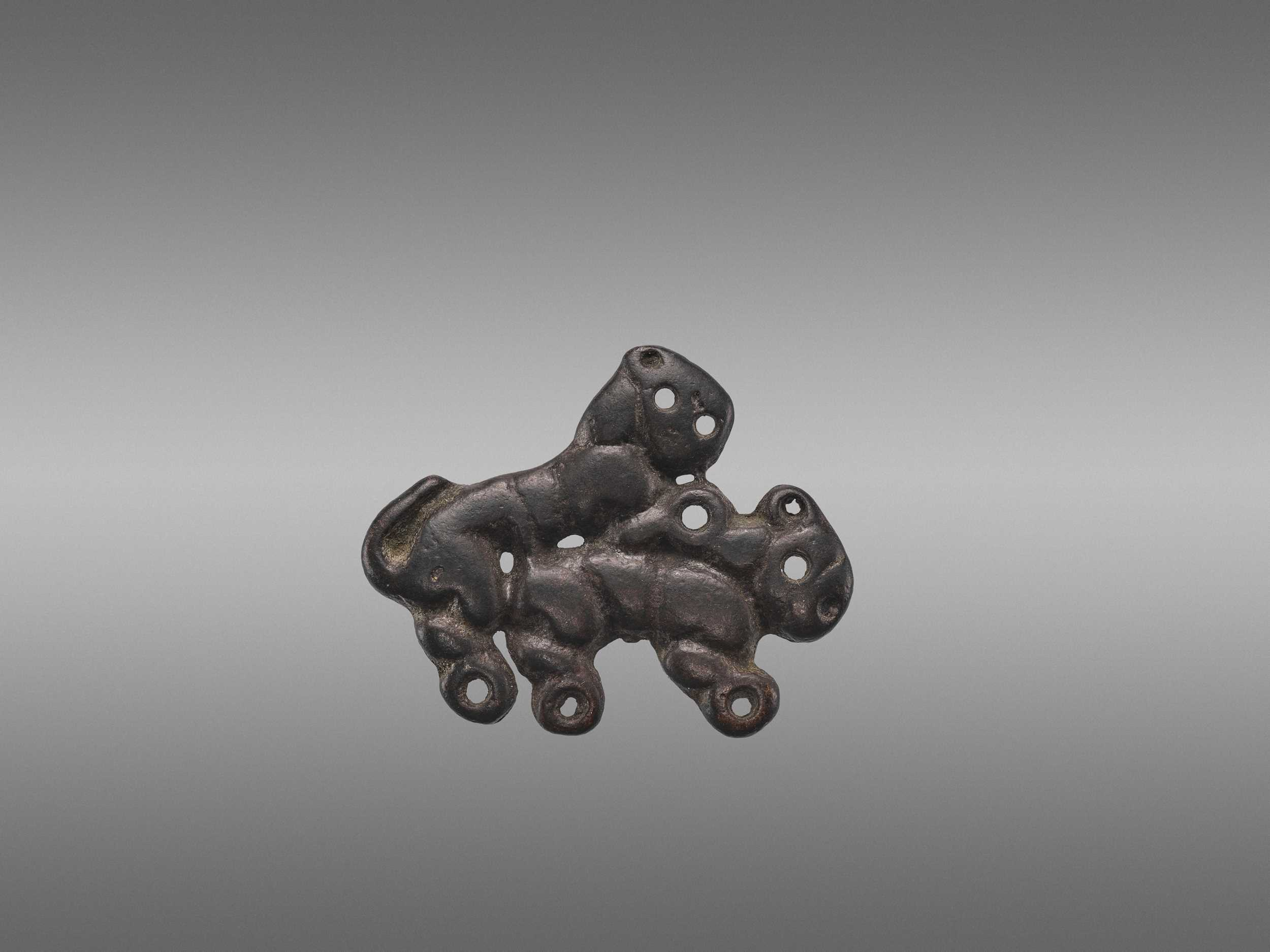 Lot 508 - AN ORDOS BRONZE 'COPULATING TIGERS' PLAQUE, WARRING STATES