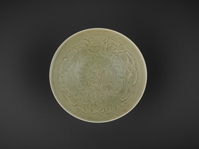 Lot 158 - A CARVED YAOZHOU 'PEONY' BOWL, SONG DYNASTY