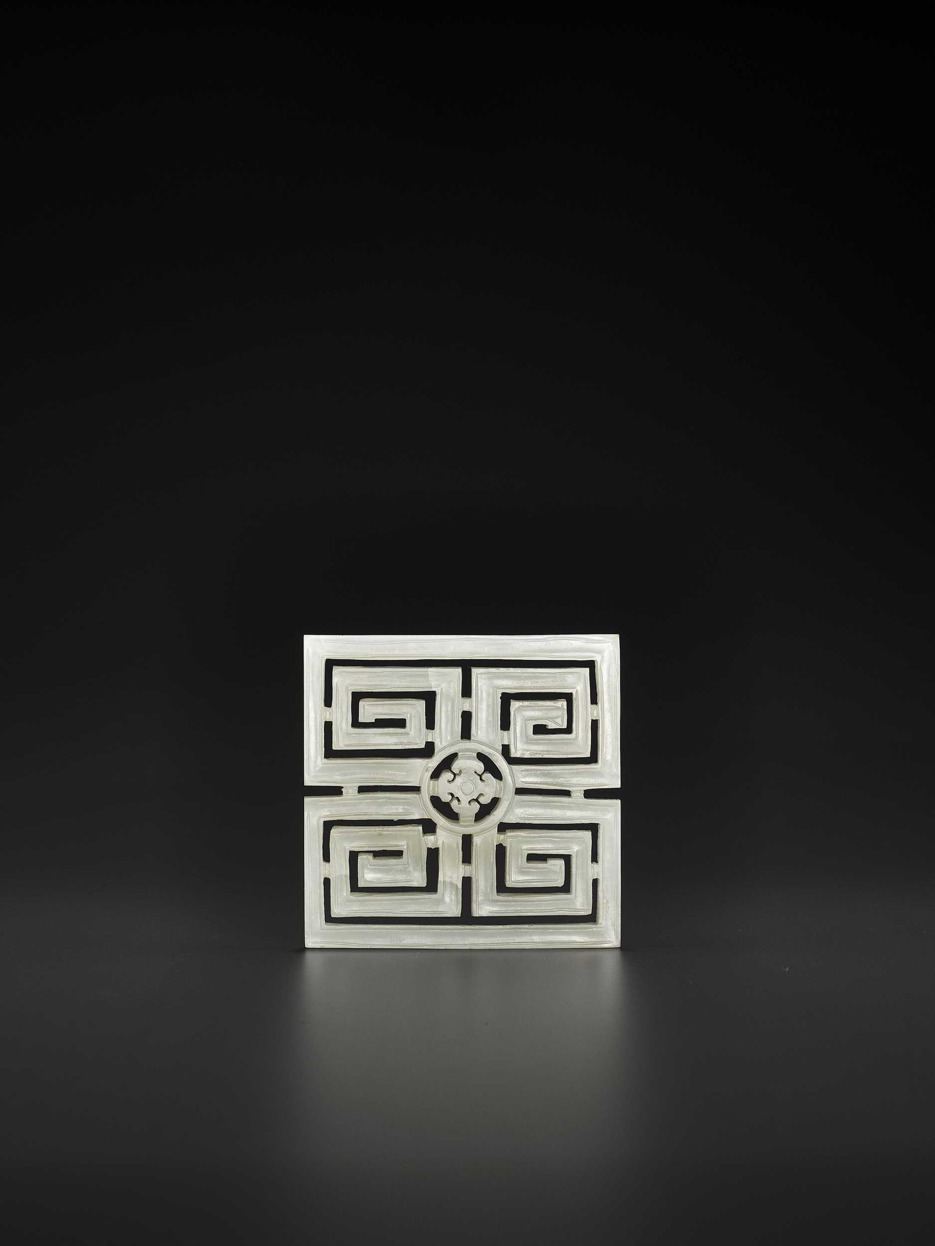 Lot 87 - A CELADON JADE OPENWORK SQUARE 'KEY FRET' PLAQUE, QING DYNASTY