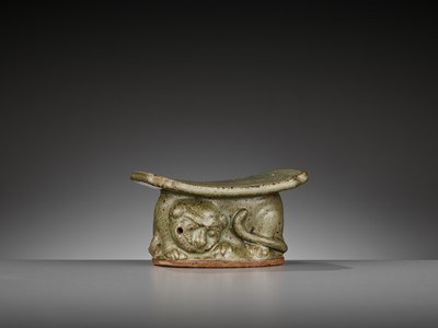 Lot 145 - A YAOZHOU CELADON 'TIGER' PILLOW OR WRIST REST WITH OFFICIAL MARK, LATE TANG TO EARLY SONG