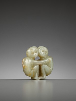 Lot 77 - A CELADON JADE 'TWO MONKEYS' PENDANT, QING DYNASTY