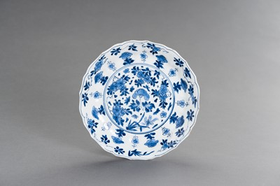 Lot 342 - A BLUE AND WHITE PORCELAIN 'FLORAL' LOBED AND BARBED-RIM BOWL, KANGXI MARK AND PERIOD